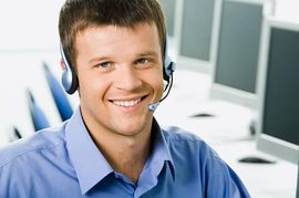 Contact center rep with headset on.