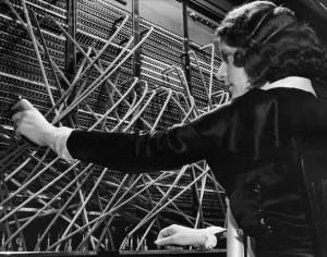 Old-time manual telephone operator connecting calls by hand.